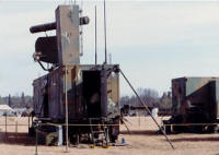 Equipment Trailer nearest in photo, Maintenance trailer inline and connected to the rear, RAPCON separate and to the right. ASR & IFF antennas toward center of trailer, PAR Elevation antenna nearest. (circa 1979-82)